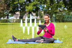 Smiling woman with tablet pc outdoors Royalty Free Stock Photos