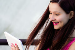 Smiling woman with tablet Stock Photography