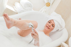 Smiling woman taking a bath Stock Photos