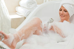 Smiling woman taking a bath Royalty Free Stock Photography