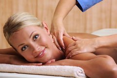 Smiling woman taking massage Stock Image