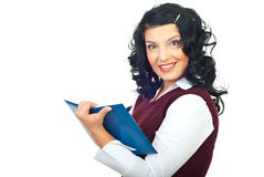 Smiling woman taking notes in her agenda Stock Photo