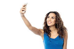 Smiling woman taking photo of herself Royalty Free Stock Image