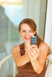 Smiling woman taking photo of herself on mobile Royalty Free Stock Photos