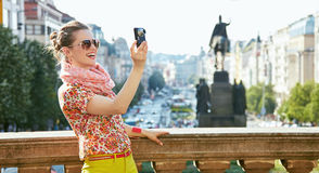 Smiling woman taking photos with digital camera in Prague Royalty Free Stock Photography