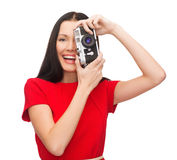 Smiling woman taking picture with digital camera Stock Images