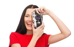 Smiling woman taking picture with digital camera Stock Photography