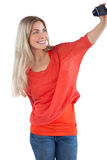 Smiling woman taking picture of herself Royalty Free Stock Photography