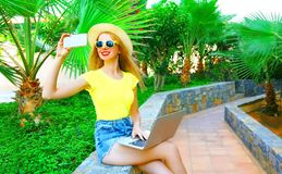 smiling woman is taking picture self portrait on smartphone Stock Image