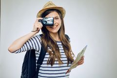 Smiling woman taking pictures with camera. Stock Photography