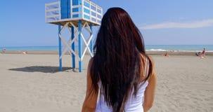 Smiling Woman Taking Self Portrait on Windy Beach stock video