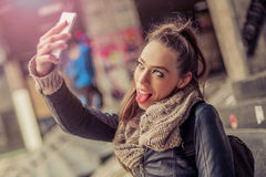 Smiling woman taking a selfie with cell phone Royalty Free Stock Images