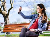 Smiling woman taking a selfie Stock Photo