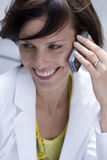 Smiling woman talking on cell phone Stock Image