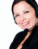 Smiling woman talking by headphone Stock Photo