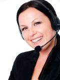 Smiling woman talking by headphone Royalty Free Stock Photos