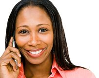 Smiling woman talking on mobile. Smiling woman talking on a mobile phone isolated over white Royalty Free Stock Images