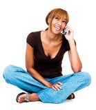 Smiling woman talking on mobile phone. Smiling woman talking on a mobile phone isolated over white Royalty Free Stock Images