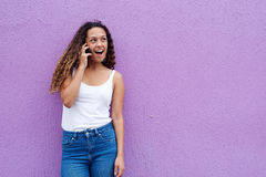Smiling woman talking on mobile phone and looking away Stock Photo