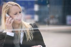 Smiling woman talking on mobile phone outdoors Stock Photography
