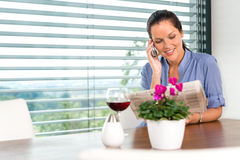 Smiling woman talking mobile phone relaxing reading Royalty Free Stock Images
