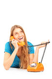 Smiling woman talking on an old styled phone Stock Image
