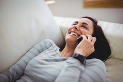 Smiling woman talking on phone Royalty Free Stock Images