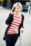 Smiling Woman Talking On Smart Phone Outside Railroad Station Royalty Free Stock Images