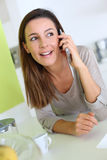 Smiling woman talking on smartphone Stock Photo