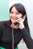 Smiling woman talking on telephone Royalty Free Stock Photos