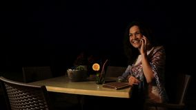 Smiling woman talking to boyfriend on the phone, happy vacation, holidays. Stock footage stock video