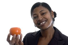 Smiling woman with tangerine Royalty Free Stock Images
