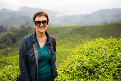 Smiling woman is on tea plantations of Cameron Highlands, Malays Royalty Free Stock Images