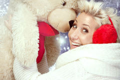 Smiling woman with teddy bear. Royalty Free Stock Images