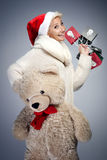Smiling woman with teddy bear. Royalty Free Stock Photos