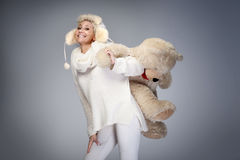 Smiling woman with teddy bear. Stock Photo