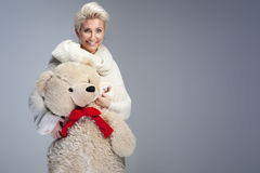 Smiling woman with teddy bear. Stock Photography