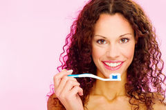 Smiling woman and teeth brush. Portrait of a smiling woman and teeth brush Stock Image