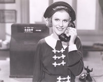 Smiling woman on the telephone Stock Photos