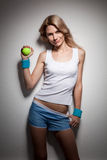 Smiling woman with a tennis ball Stock Images