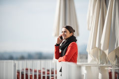 Smiling woman on a terrace Stock Photography