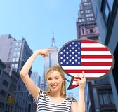 Smiling woman with text bubble of american flag Stock Photo