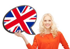 Smiling woman with text bubble of british flag. Education, fogeign language, english, people and communication concept - smiling woman holding text bubble of Royalty Free Stock Photography