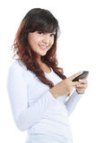 Smiling woman texting on cell phone. Portrait isolated on white background Royalty Free Stock Image