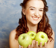 Smiling woman with three green apple Stock Images