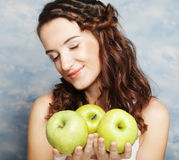 Smiling woman with three green apple Stock Photography