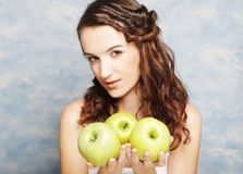 Smiling woman with three green apple Royalty Free Stock Photo