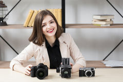 Smiling woman with three photo cameras Royalty Free Stock Photos
