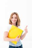 Smiling woman with thumbs up gesture and folder Stock Photo