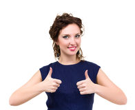 Smiling woman with thumbs up gesture posing Stock Photos